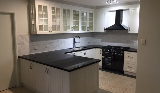 Hampton style kitchen designed by all about kitchens qld for Hamptons style kitchen splashback